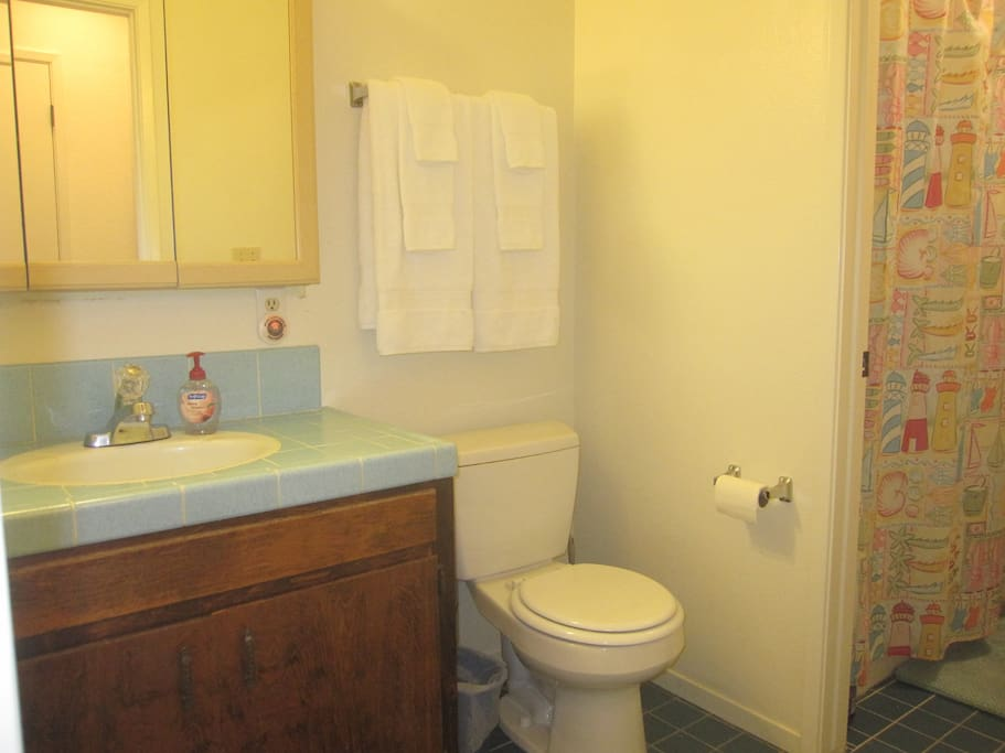 Private half bath with essentials; shared tub/shower.