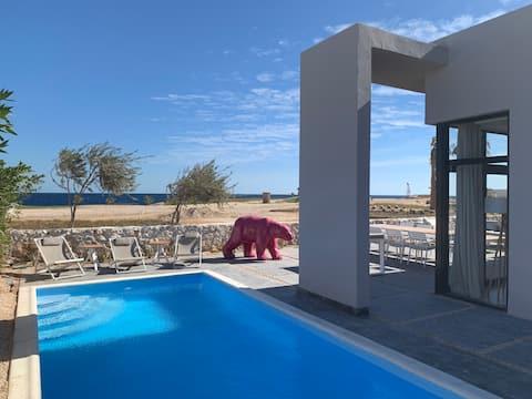 Villa amb vista al mar i golf a la badia de Soma