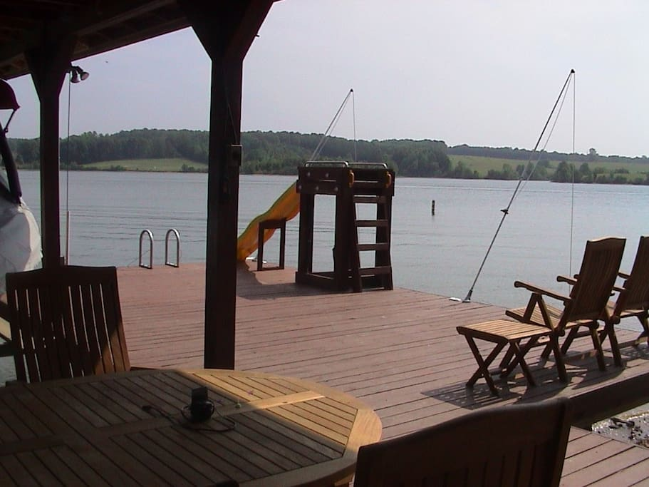 Lakefront near Lake Anna State Park with large dock, covered eating area,  and sliding board