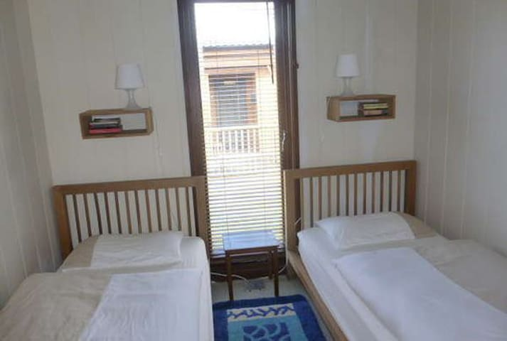 Bedroom 3 with 2 full size single beds.