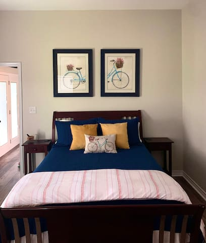 Master bedroom with a bicycle theme. Phone charging pads  on each side of bed for your convenience.