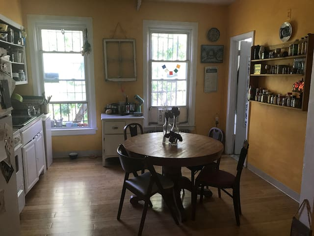 Large kitchen with a large table and many spices