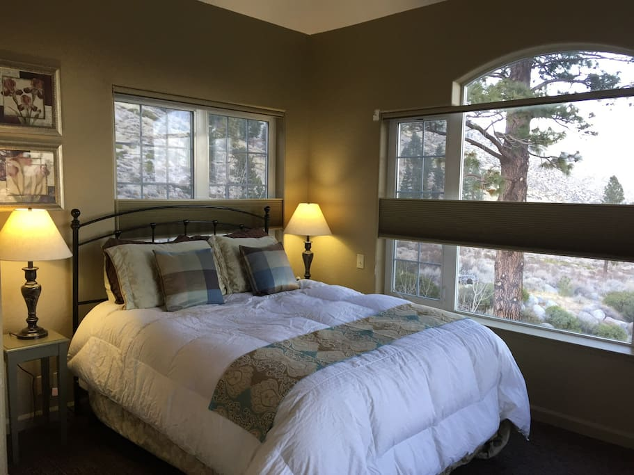 Master bedroom with private bathroom.  Beautiful views and calming sound of water from Mott Creek