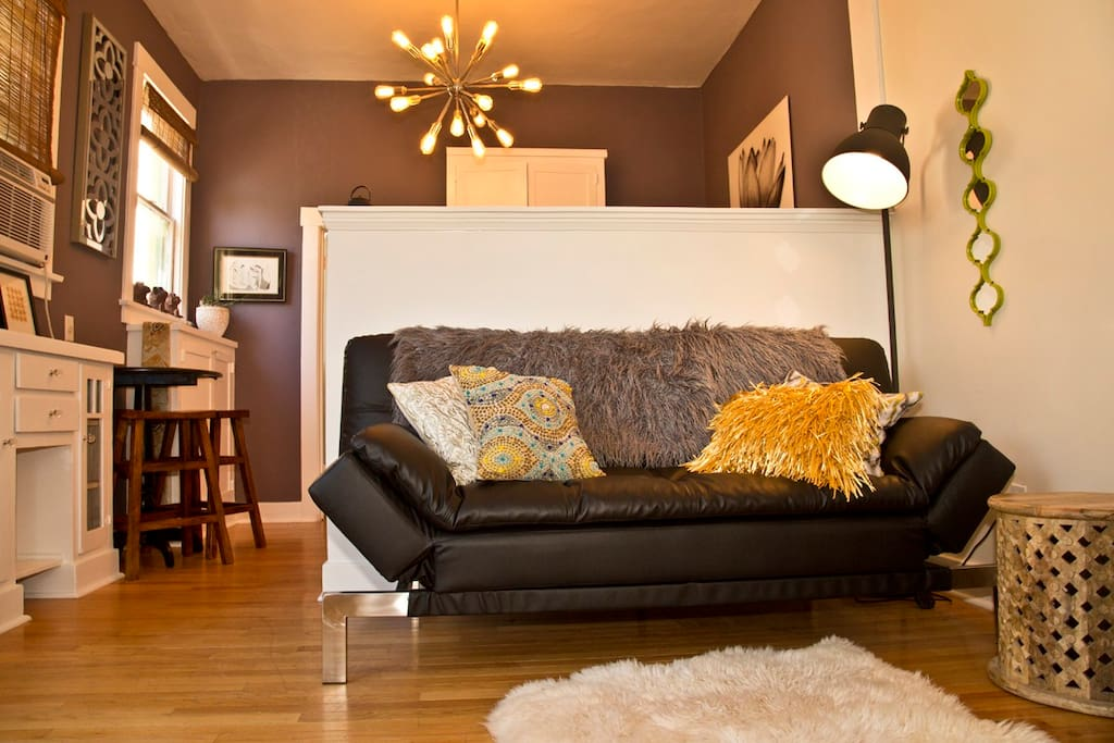 High ceilings and glossy hardwood floors throughout the apartment