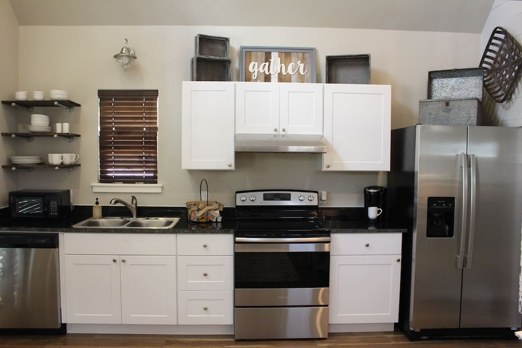 Our beautiful kitchen is complete with stove, dishwasher, refrigerator, microwave, Keurig and a gas grill! You will also find our kitchen stocked up with dinner ware, flat ware, cook ware and basic utensils! Everything you should need to prepare a wonderful meal and make memories that will last a lifetime!
