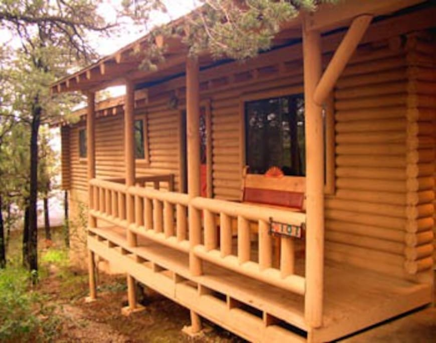 Front covered deck - a great place to sit and watch the wildlife such as deer, hummingbirds, blue birds and wild turkeys