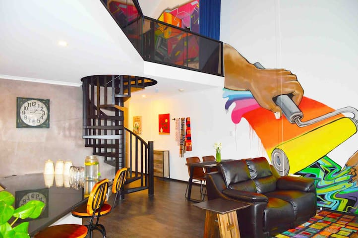 "We love our open planned ""modern Industrial "" loft apartment with polished concrete and colourful streetart to brighten your day"