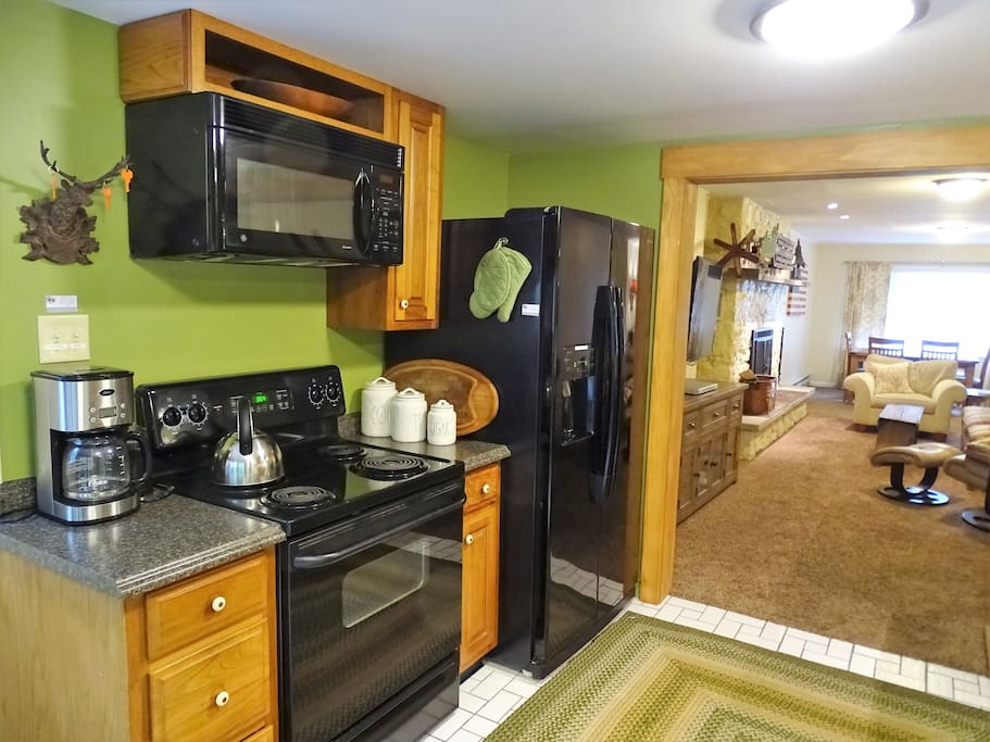 Fully equipped kitchen brings the outdoors in - and step right outside to the screened in porch to share a meal or relax.