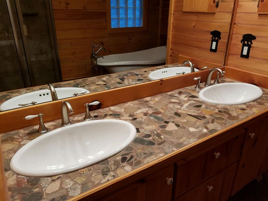 Natural stone vanity in master bath
