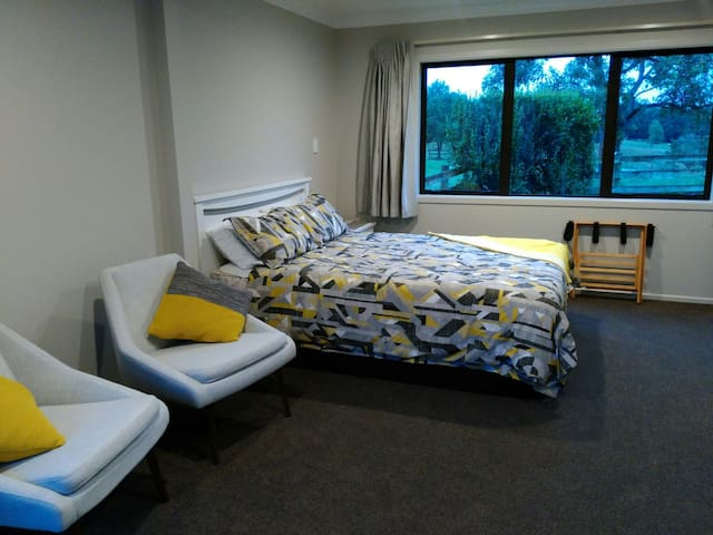 Master bedroom, 1 x queen double bed, TV and lounge chairs