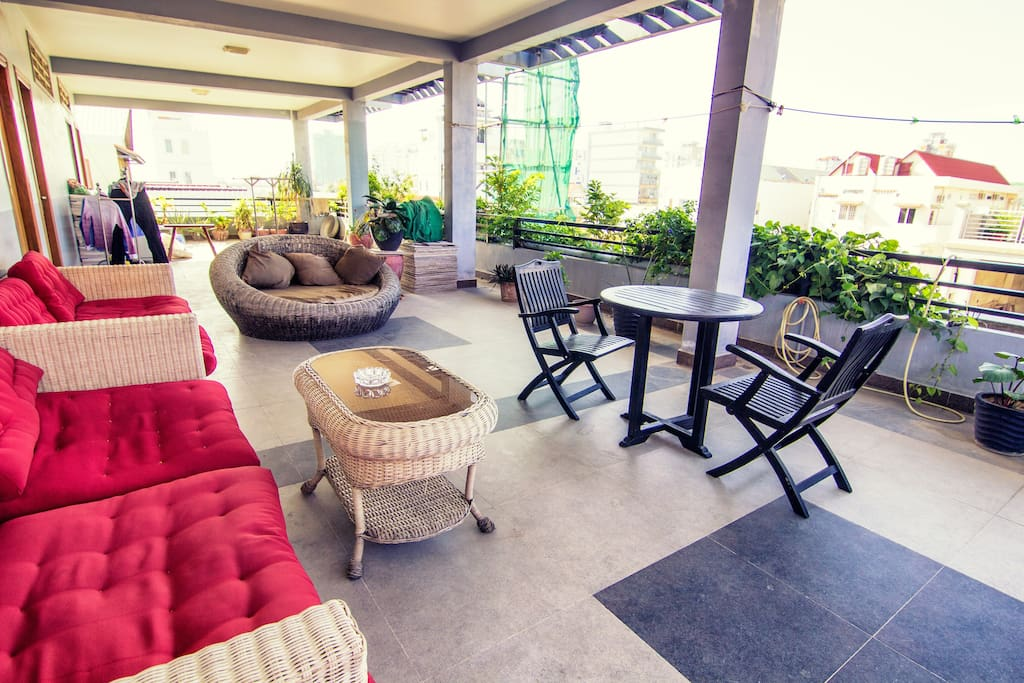 Shared upstairs terrace with large couches