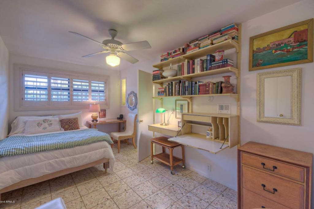 Guest bedroom. Sleeps two in a comfy full sized bed with tidy workspace. Walk in closet & adjoining full bath also a part of this functional room.