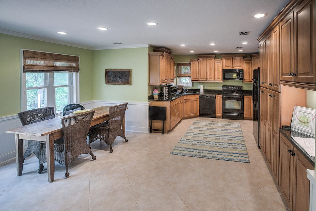 Open floor plan; view from family room into kitchen/dining
