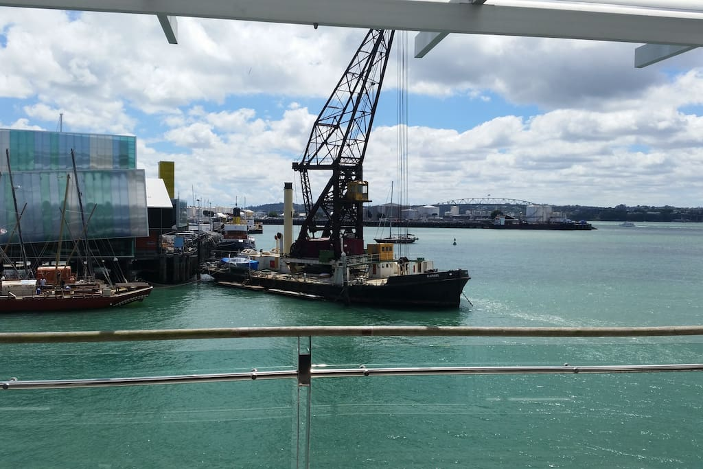 View form the apartment living room with the Viaduct harbour and the Auckland harbour bridge.