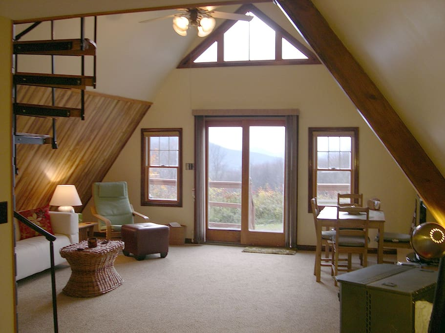Great Room looking west; glass-fronted wood stove visible in lower right corner
