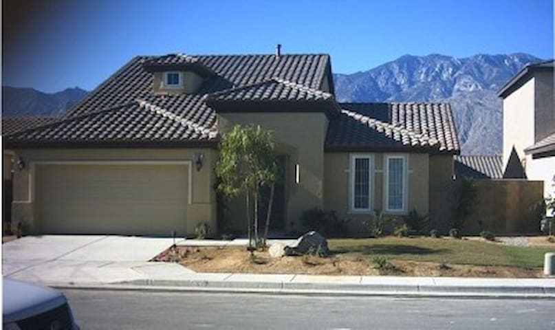 Front Entrance with View To Majestic Mountains in Background