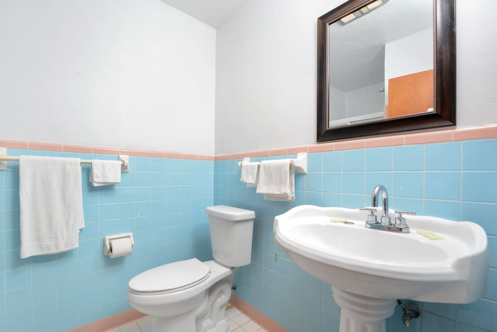 Clean roomy bathroom, energy efficient toilets
