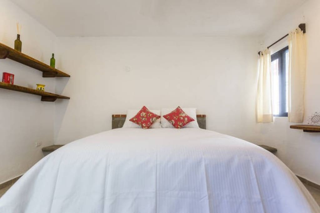 Bedroom with high quality queen size bed, air conditioner and spacious closet