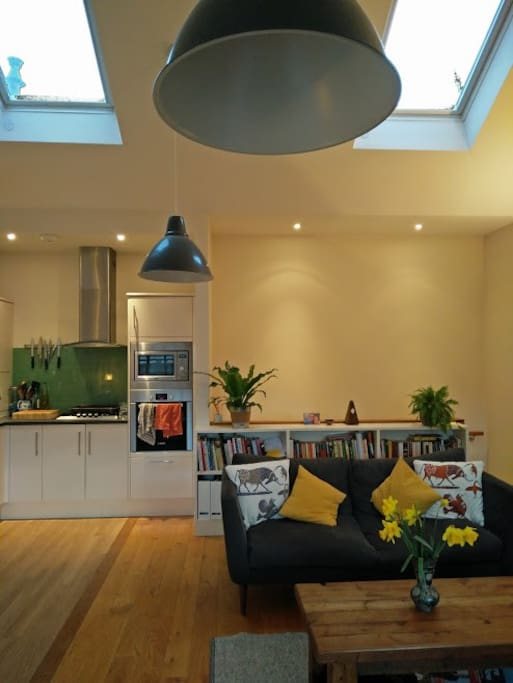 Bright living space from large windows and overhead automated skylights