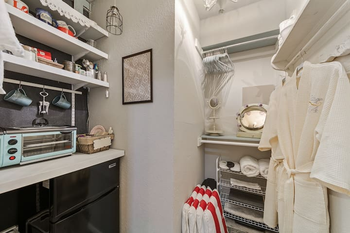 Walk in closet with plenty of hanging space, hotel quality robes, slippers and mini kitchenette.  PLEASE note, there is only a microwave, coffee maker and electric tea kettle.  Microwave recently replaced for toaster over.
