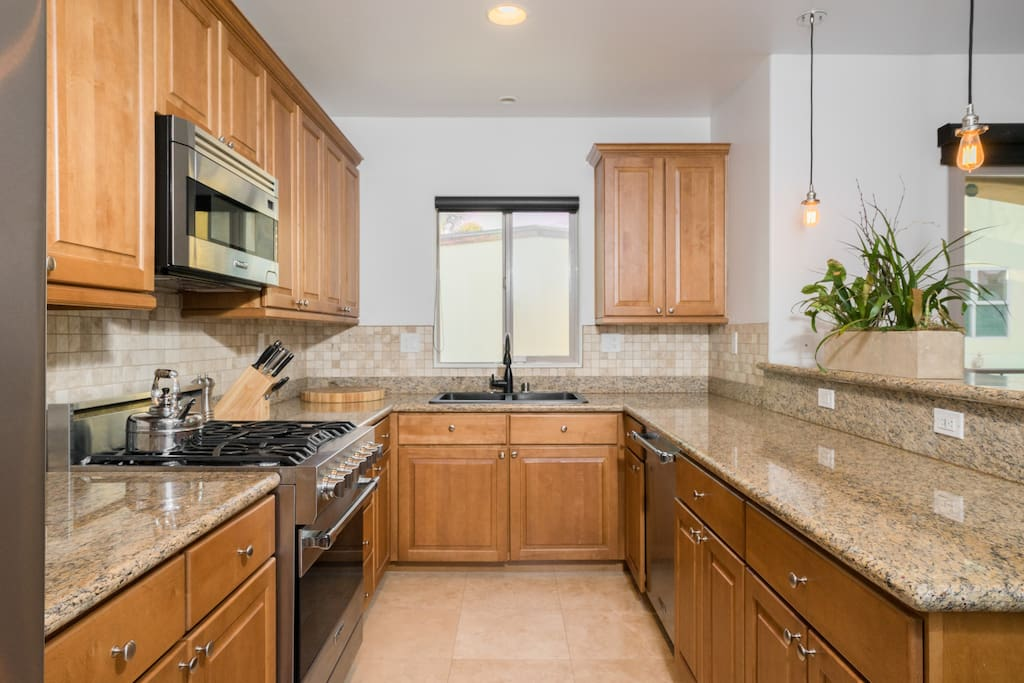 State of the art kitchen with gas stove, dishwasher, walk-in pantry and breakfast bar