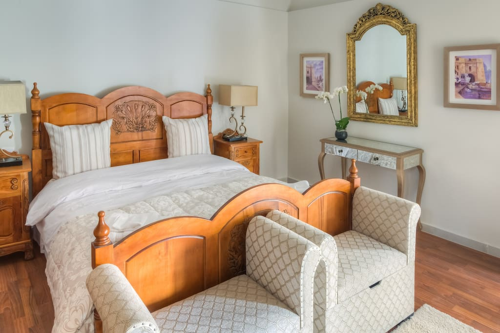 Luxurious king size bed with en-suite bathroom and balcony
