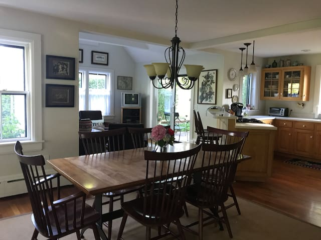 Shot of Dining room, kitchen and living room.