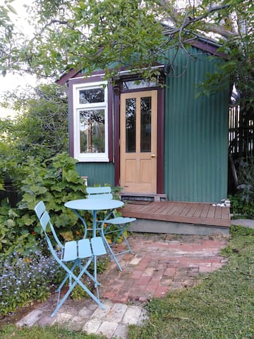 Seating area. Deck chairs are also available from under the bed, for more relaxed garden seating.