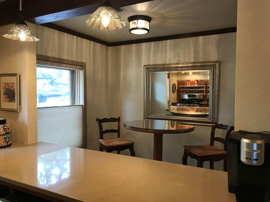 Dining nook opens to the kitchen