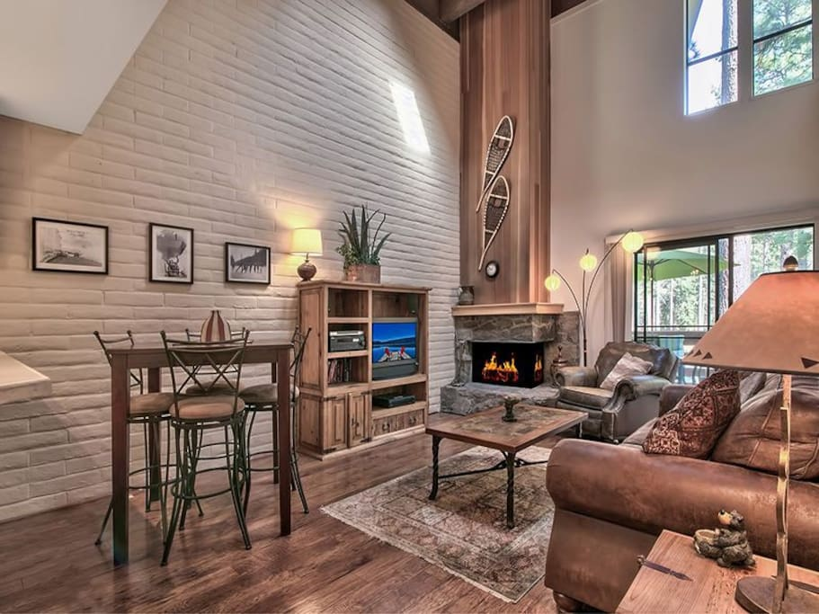 Cozy and bright living room. Private patio with gas BBQ and seating.