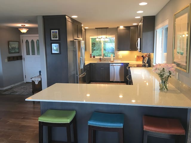 Bar seating and custom kitchen.