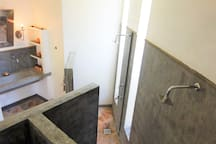 spa style bathroom with three showers
