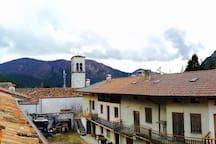 Panoramic view from the balcony between woods and roofs