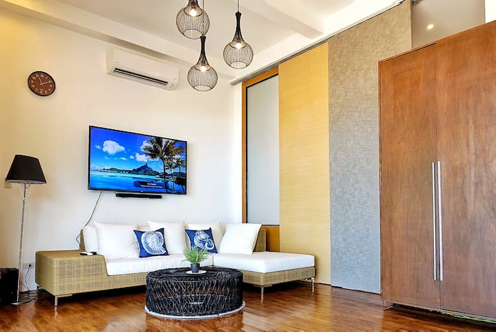 Living room with breathtaking ocean view.  can be divided by a moving wall. 65 inch TV. bluetooth stereo.