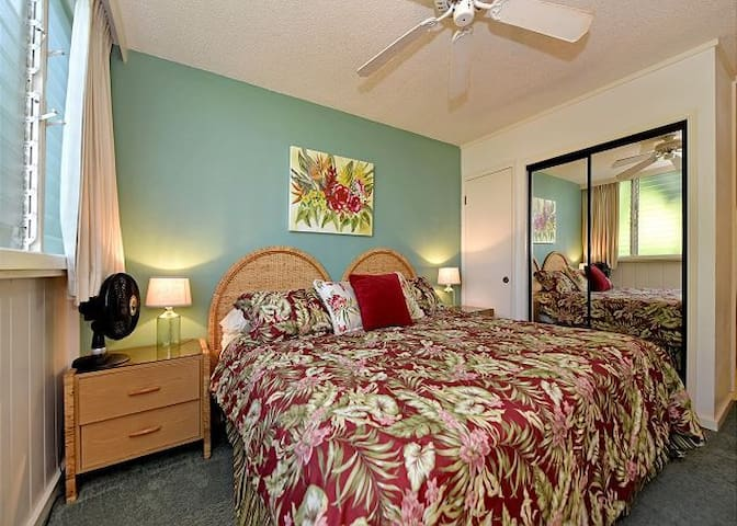 Comfortable King size bed with cooling ceiling fan.