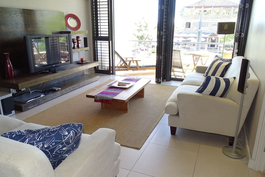 Lounge with large flatscreen including premium package DSTV, DVD player and comfy couches