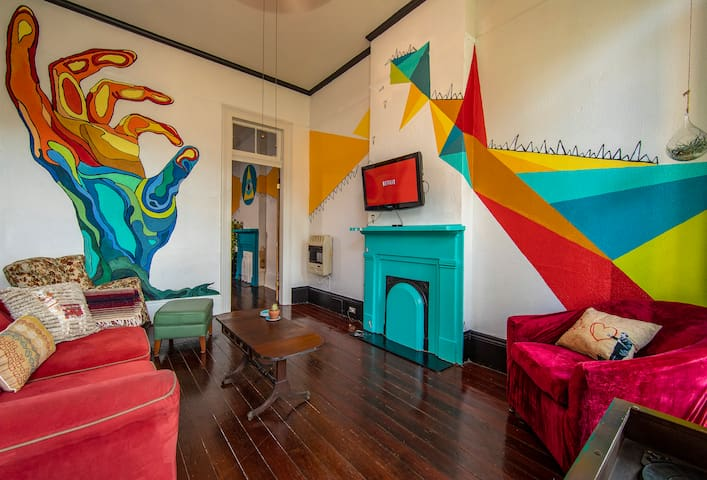 Artist's mural filled shotgun home