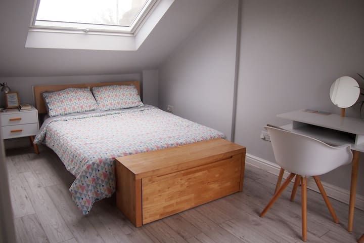 Cosy loft with ensuite in relaxed, family home