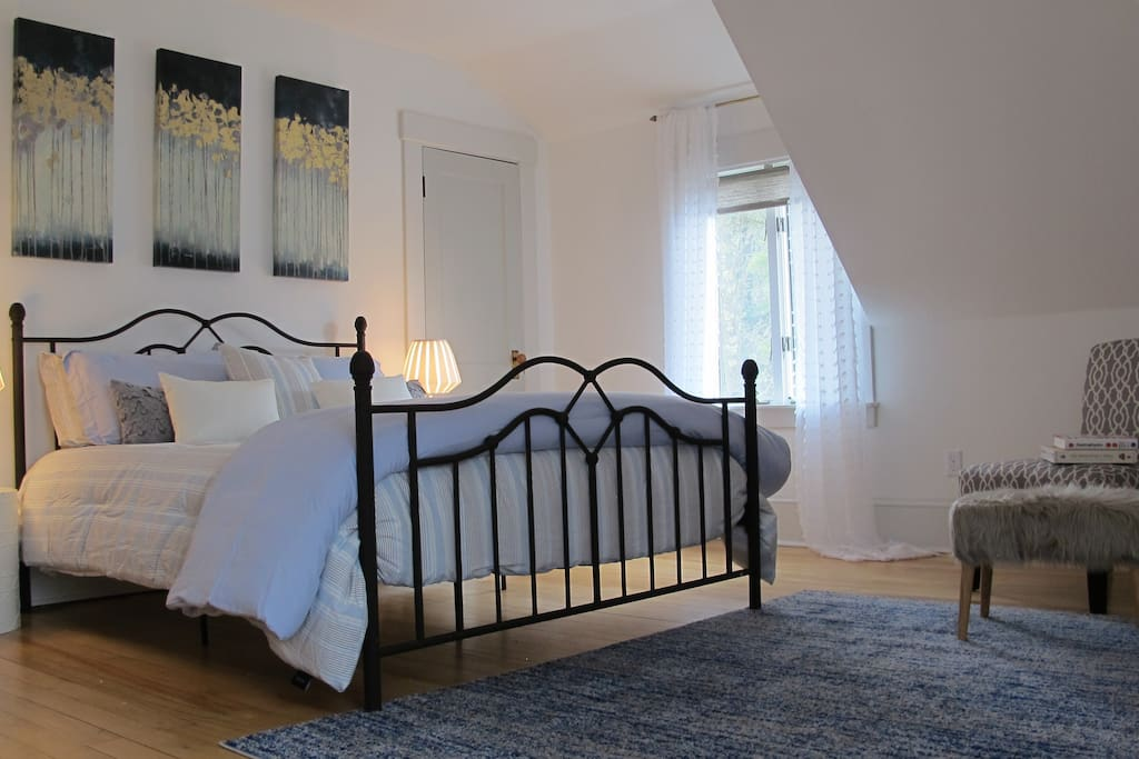 A queen bed, built in closet & incredible natural light with views over Penobscot Bay and wildflower meadow... Sounds a lot better than a motel right!