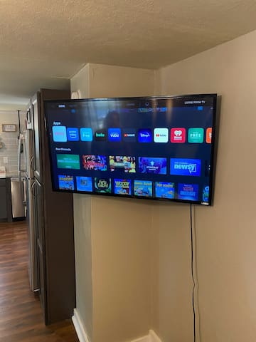 Pic of smart tv. Netflix account with your name.  Can be pivoting to watch in kitchen or sitting in LR. Or from watching if sleeping on sofabed.