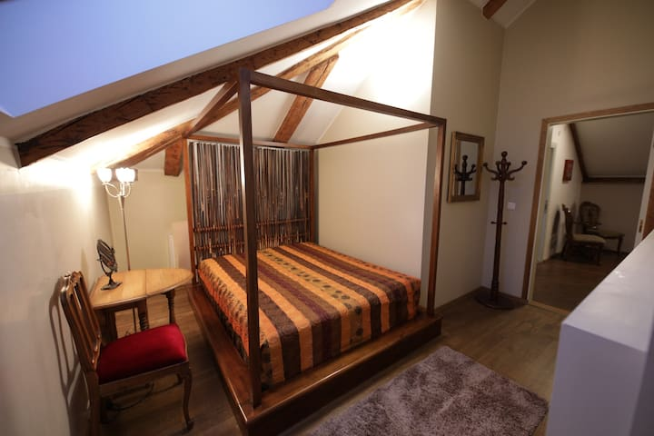 Bedroom 1. Double bed + passage to the hidden part of the room with Single bed.