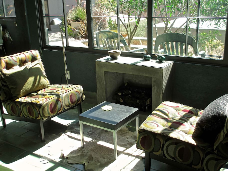 Seating area with fireplace overlooking the garden.