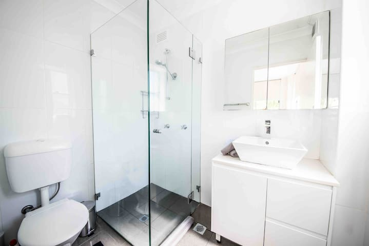 Bathroom with shower, hair dryer and toiletries supplied