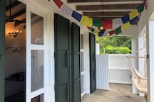 private entrance to one of the rooms with blessing flags from Nepal