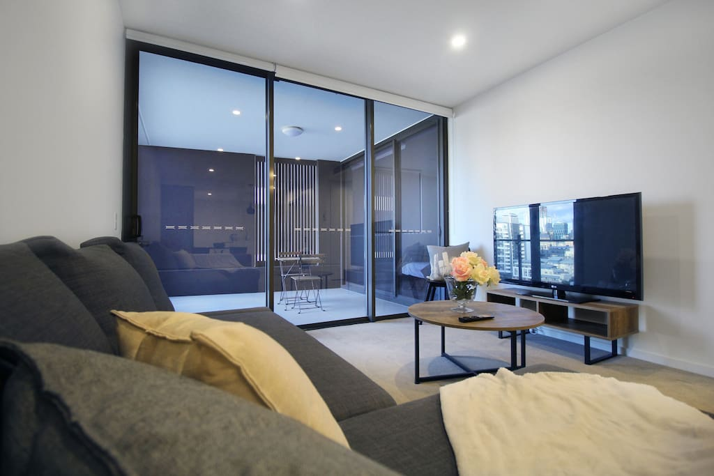 Living space with smart TV linked to wireless access to enhance the entertainment experience.
