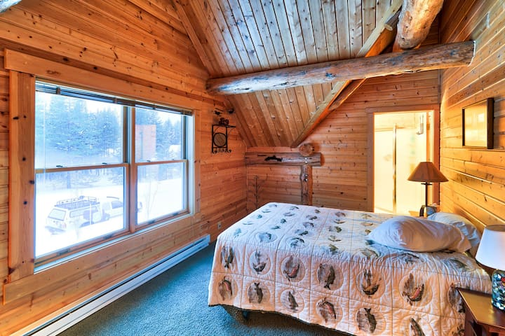 Each of the four bedrooms provides a comfortable queen bed and beautiful forest views.