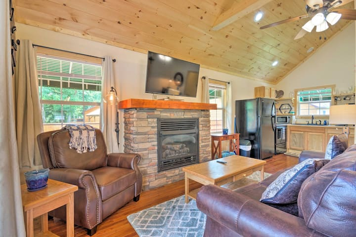 Charming Riverfront Cabin w/Private Deck & Hot Tub