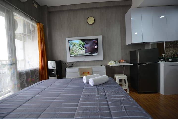FreeWifi furnish studio room @Caman Jatibening tol