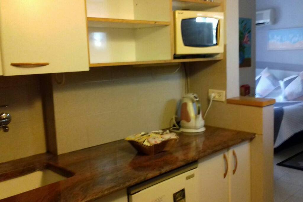 kitchenette with mini fridge 2 electric burners microwave kettle tea coffee...