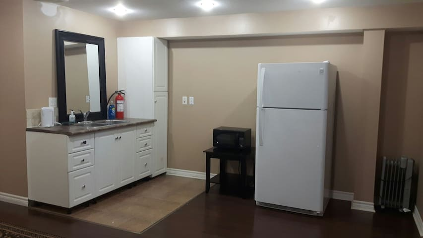 full size fridge, microwave. some dishes